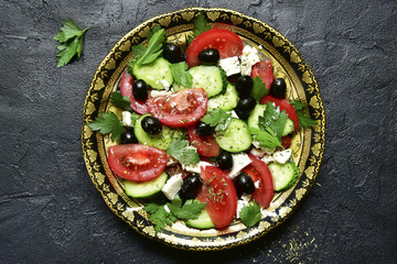 Vegetable salad with feta cheese - traditional dish of greek cuisine.Top view with copy space.