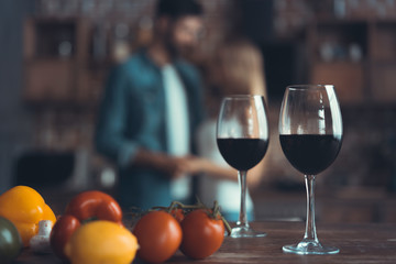 kitchen background with wine and two glasses.