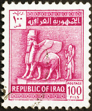 Assyrian statue on old iraqi postage stamp