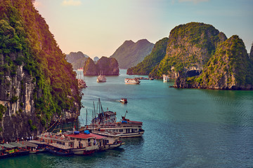 Tourist Junks in Halong Bay,Panoramic view of sunset in Halong Bay, Vietnam, Southeast Asia,UNESCO World Heritage Site