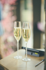 two blurred glasses of champagne for newlyweds