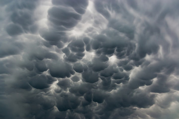 Mammatus clouds fill the sky in czech countryside