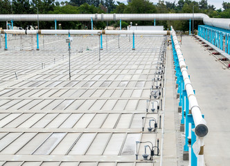 rows of metal panels with large pipes at a water treatment facility
