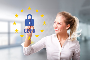 businesswoman is selecting GDPR via touchscreen in front of an office scene