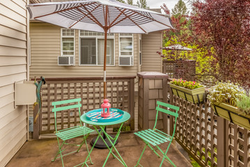 cafe bistro set on outdoor patio deck