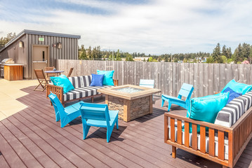 rooftop deck with modern blue patio furniture
