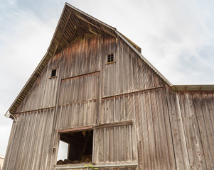 old natural wooden barn with pointed roof