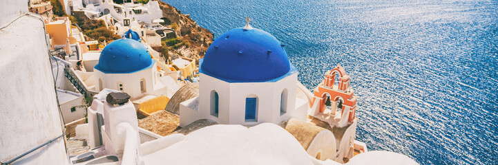 Wall Mural - Santorini Greece Europe travel vacation banner. Oia city, Famous european tourist destination Three Domes church panoramic view. Horizontal landscape banner crop for advertisement copy space.