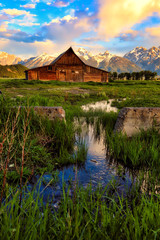 Mormon row with the Grand Tetons in the background is one of the most popular destinations in Jackson Hole Wyoming.