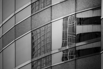commercial building detail, glass surface with B&W color