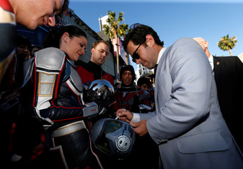 "Paul Rudd signs autographs at the premiere of the movie ""Ant-Man and the Wasp"" in Los Angeles"