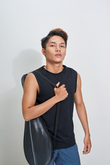 Asian badminton player with bag on white background