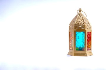 Ramadan / Eid lantern isolated. Arabic decoration lamp on white background. Selective focus and crop fragment