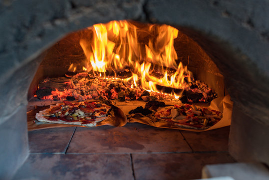 Pizza oven with flame, fire and pizzas