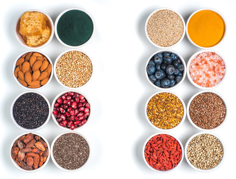 Various superfoods in bowl oisolated on white