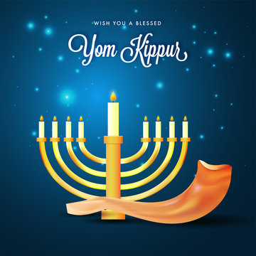 Menorah with burning candles and shofar horn on blue lights background for Yom Kippur concept.
