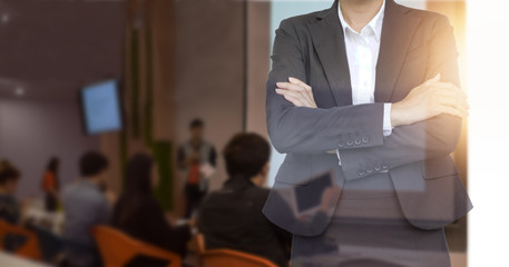 Double exposure of business people at meeting hall background.