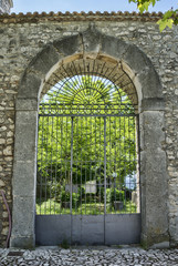 Medieval arched entrance with iron gate