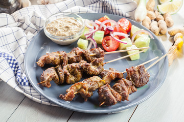 Traditional pork satay with peanut sauce and vegetables
