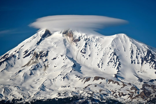Clear view of volcano with smoke. Lenticular clouds over starato volcano Mount Adams near Portland, Oregon. Washington State. United States of America.