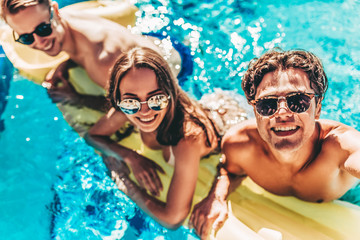 Young friends in swimming pool