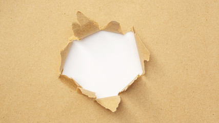 Brown paper was ripped at the center.