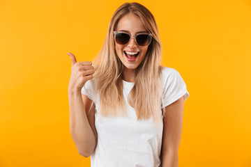 Portrait of a cheerful young blonde girl in sunglasses