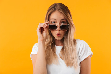 Portrait of a lovely young blonde girl in sunglasses