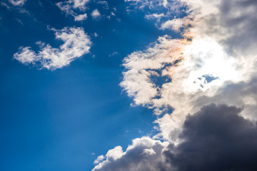Big and heavy clouds on blue sky background