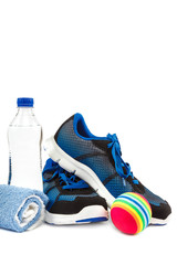 Stylish sneakers, towel and water bottle on white background.