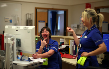 The Wider Image: Pride and worry, Britain's free health service turns 70