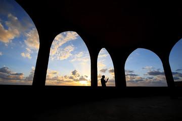 Silhouette of Man Taking Selfie