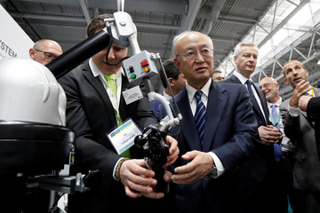 Director General of the International Atomic Energy Agency (IAEA), Yukiya Amano and French Finance Minister Bruno Le Maire visit the World Nuclear Exhibition (WNE), the trade fair event for the global nuclear community in Villepinte