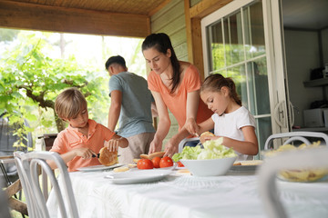 Family on vacation preparing outdoor lunch