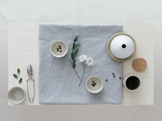 A styled tea ceremony inspired by a Japanese mood with a collection of ceramics and jasmine tea pearls.