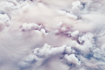 Abstract background of clouds made of smoke from dry ice in color pink