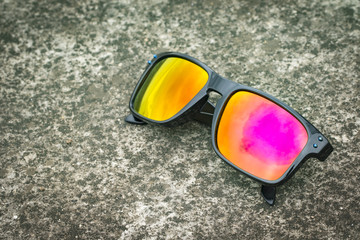 Image of modern fashionable sunglasses on the floor, Glasses.
