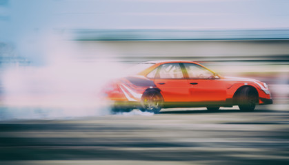 Dramatic car drifting, Blurred of image diffusion race drift car with lots of smoke from burning tires on speed track