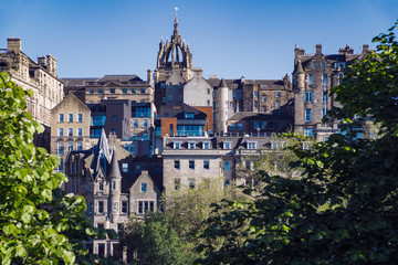 A view of Edinburgh Old Town, as seen from the famous Princes Street Gardens.  Scotland, UK.  The spire in the centre of the skyline is St Giles Cathedral.
