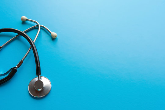 Stethoscope on a blue background, the tool of the doctor. The concept of medicine.