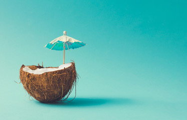 Tropical beach concept made of coconut fruit and sun umbrella. Creative minimal summer idea. Wall mural
