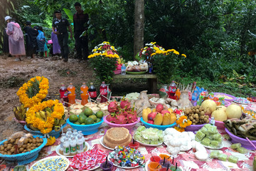 Fruits, desserts and drinks are placed as offerings to the spirits near the Tham Luang caves, where 12 members of an under-16 soccer team and their coach are trapped, in Chiang Rai