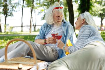 Wedding anniversary. Pleasant nice couple organizing a picnic while having a celebration