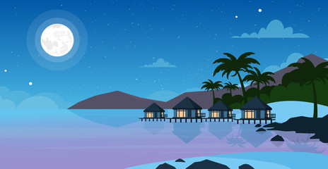 Vector illustration of beautiful night sea beach with hotel. Small villas on the ocean seaside in night time with moon and stars on the sky. Summer landscape, vacation concept in flat style.