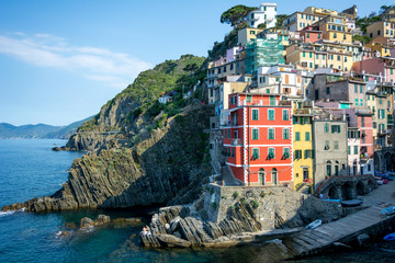 Horizontal View of the Town of Riomaggiore Builded on the Cliff on Blue Sky Background.