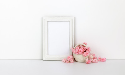 Vertical wooden frame mockup with pink flowers, basket