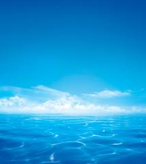 Blue ocean and cloudy sky