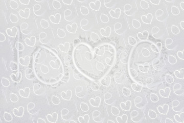 Text love collage from handwritten on flat snowy winter surface