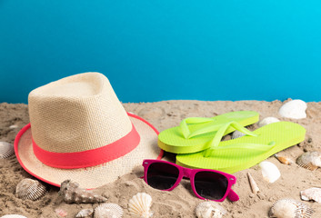 flip flops with sunglasses and strand hat