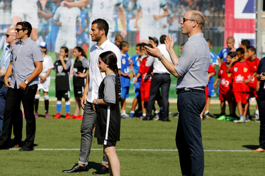 Britain's Prince William stands next to Tomer Hemed during a soccer event organized by The Equalizer and Peres Center for Peace in Jaffa